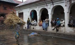 People take shelter at the Pashupatinath temple in Kathmandu, Nepal, one of the buildings to survive the earthquake.