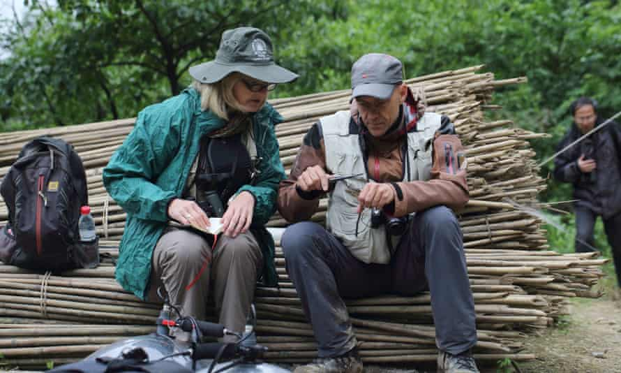 Per Alström and a co-author, Pam Rasmussen (assistant professor of zoology at Michigan State University), measure one individual of the new species. (A third co-author, Bo Dai, Leshan Normal University, China, is in the background). Laojun Shan, Sichuan province, China, May 2014.