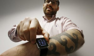 Reuters journalist Matt Siegel inputs his passcode on to his Apple Watch as his tattoos prevent the device's sensors from correctly detecting his skin.