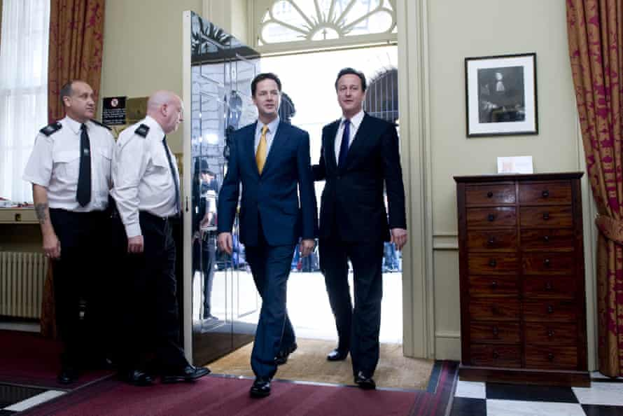David Cameron and Nick Clegg walk into 10 Downing Street on 12 May 2010.
