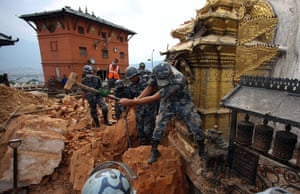 Rescue team members search for victims in a collapsed temple