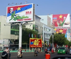 A street is decorated with posters marking the  40th anniversary of the fall of Saigon in Ho Chi Minh City.