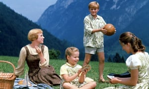 Julie Andrews, as Maria, and three of the Von Trapp children in the 1965 musical The Sound of Music.