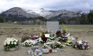Flowers in front of a stone commemorating the victims of the Germanwings Airbus A320 crash in the village of Le Vernet.