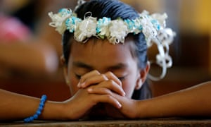 A Filipino girl praying at Easter Sunday mass in Aurora province in the Philippines.