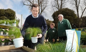 George Osborne restocks plant displays during a visit to a garden centre in west London.