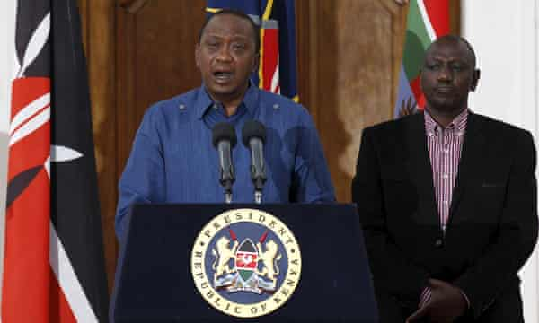 President Uhuru Kenyatta, flanked by deputy William Ruto, holds a news conference on Saturday after the massacre.