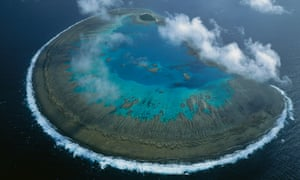 07 Oct 2005, Australia --- Lady Musgrave Island coral atoll in Capricorn-Bunker group, Great Barrier Reef Marine Park, World Heritage Site, Queensland, Australia --- Image by   D. Parer & E. Parer-Cook/ Auscape/Minden Pictures/Corbisaerial viewAustralasiaAustraliacoral reefCoral SeadaytimeGreat Barrier Reeflandscapemarine scenenobodyOceaniaPacific OceanQueenslandreefseascapeSouth Pacific OceanUNESCO World Heritage Siteview from aboveWest Pacific Ocean   ADV BARRIER REEF