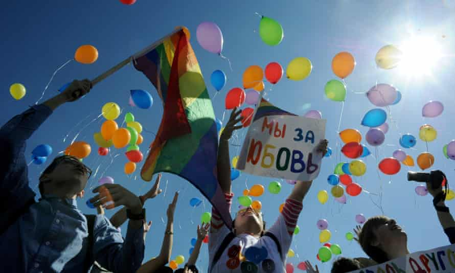 Gay rights activists release balloons as they take part in a rally in St Petersburg