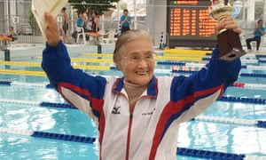 Mieko Nagaoka, a 100-year-old Japanese swimmer, celebrating in a masters swimming competition in Matsuyama, Ehime prefecture.