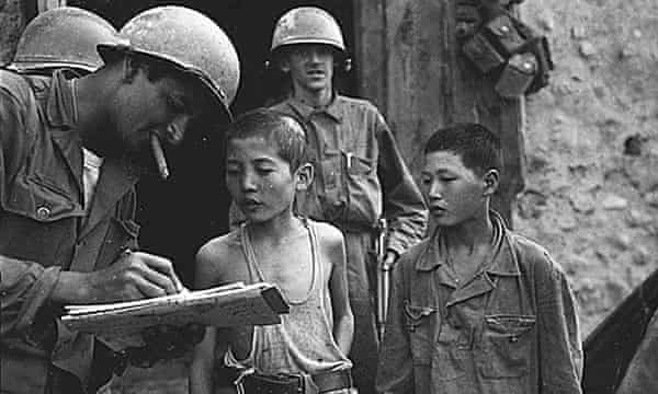 US soldiers questioning North Korean boys during the Korean war in 1950. US soldiers questioning North Korean boys during the Korean war in 1950. The brainwashing of captured GIs led to research by social psychologists into resistance to persuasion.