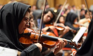 Tehran Symphony Orchestra musicians rehearse in 2010, before the orchestra was disbanded for lack of funds in 2012.