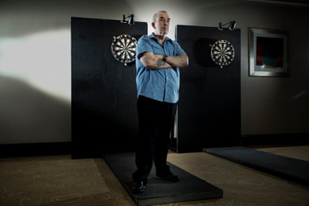 Taylor at a practice session in Manchester. He began playing darts with his father at the age of 12.