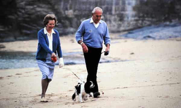 Margaret and Denis Thatcher take a dog for a walk.