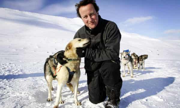 David Cameron hugs a husky