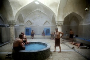 A group of men bathe at the Nezafat public bathhouse in Tabriz, Iran. The steamy air and curved tiled walls of Iran s famed public bathhouses, some rinsing and massaging patrons for hundreds of years, slowly may wash away as interest in them wanes. The bathhouses, known as hammams in Persian, find themselves in rough financial times as modern conveniences now allow showers and baths in most homes across the Islamic republic.