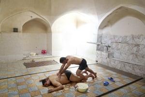 Heidar Javadii, 39, a bathhouse worker, massages a man at the Setareh public bathhouse in Yazd, Iran.