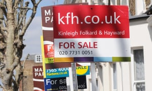 Property sale signs in west London.