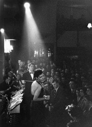 Billie Holiday in the spotlight onstage in 1959