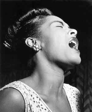 Billie Holiday performs in a New York nightclub in 1947 taken by Bill Gottlieb for Downbeat magazine