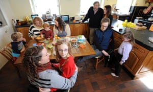 Anna Caig (foreground, with daughter Elsie), her mother Fiona and father Duncan, and other members of her family in the kitchen of Knowsley Farm.