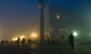 a gondolier walks in St Mark's Square  in Venice.