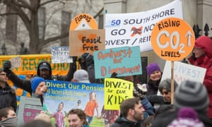 Environmentalists rally in Boston to demand state legislators support a bill that would require divestment from the state's fossil fuel holdings, 26 February 2014.