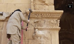 A militant attacking an ancient wall in Hatra.