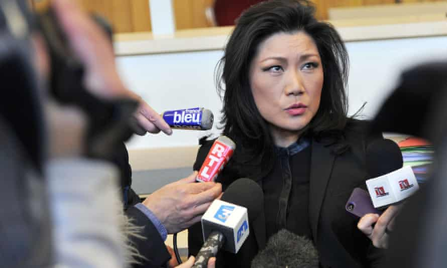 Lise Han talks to journalists on Tuesday, the first day of the trial in Tours.