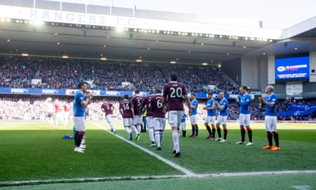 Rangers players form a guard of honour for Hearts players at Ibrox.