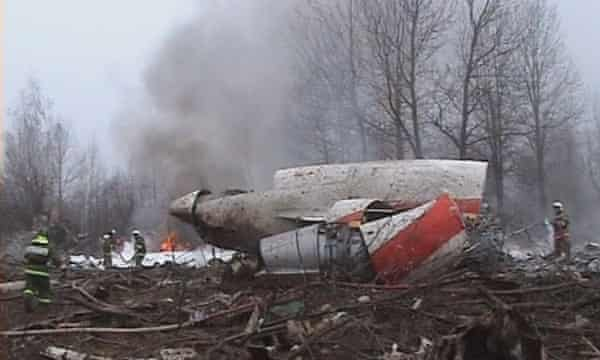 A firefighter walking near some of the wreckage at the crash site.
