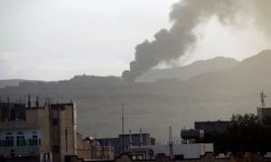 Smoke rises over Sana'a after airstrike by Saudi-led coalition against Houthi rebels in Yemen.