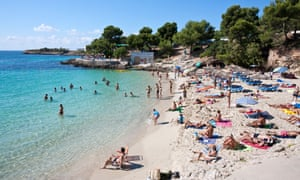Tourists at the beach in Mallorca, Spain.