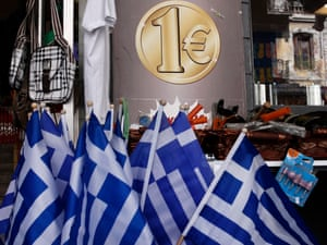 Greek national flags are displayed for sale at the entrance of a one euro shop in Athens, Greece.