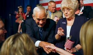 Ron Paul and his wife Carol, parents of Rand Paul, greet supporters before Rand Paul announced his candidacy for president.