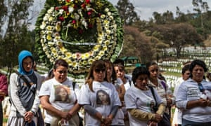 Mothers with missing daughters accompany Maria Eugenia Fuentes and her family at the funeral of her daughter Diana.