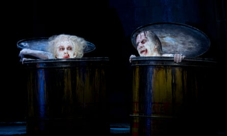 Sarah Peirse and Bruce Spence, playing Nell and Nagg, pop out of their trashcans.