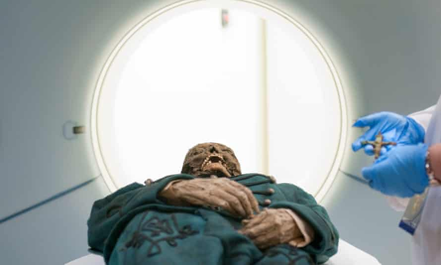 One of the Vac mummies emerges from a CT scanner. It is one of a group of mummies found in 1994 in a forgotten church crypt in Vac, Hungary. T