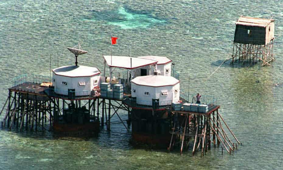 China's flag flies over structures built on stilts in the disputed Spratly Islands. The US is concerned disputes between China and others who lay claim to such territories could be militarised.