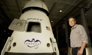 Elon Musk poses in front of the Dragon space craft.