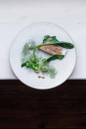 Brown butter-poached sea bass, spinach and oak-smoked roe