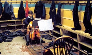 Boot room: a young musician finds a quiet spot to practise at Aberlour House.