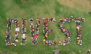 Hundreds of 350.org activists brave the rain in Melbourne, Australia ,to spell out their message loud and clear on Global Divestment day,  14 February 2015.