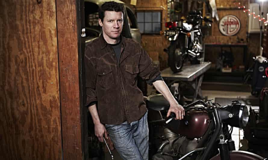 Matthew Crawford in his garage, spanner in hand