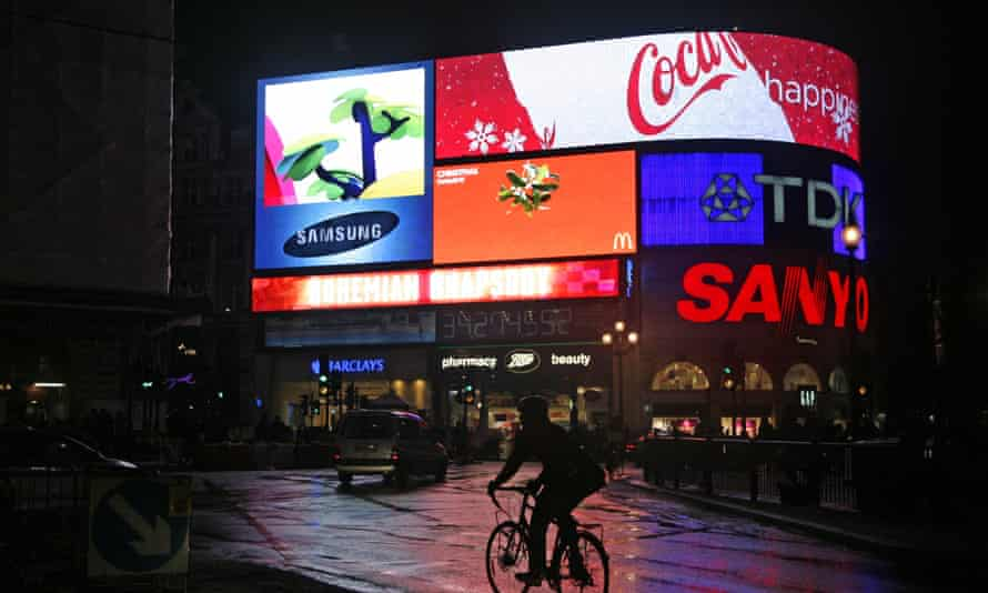 The brightly lit adverts at Piccadilly Circus.