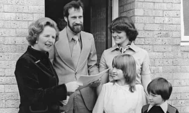 Margaret Thatcher hands over the deeds to a council house in 1979
