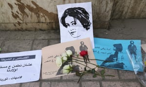 Flowers are seen left at the spot where activist Shaimaa Sabbagh died during a protest on Saturday, in central Cairo January 29, 2015.
