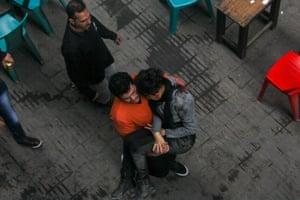 An Egyptian supporter of the Socialist Popular Alliance carries member Shaimaa al-Sabbagh