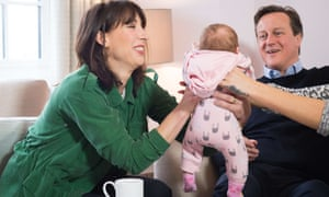 David Cameron and his wife, Samantha, pass baby Regan between them during a campaign visit to a housing development with a family in Chorley, Lancashire.