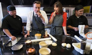 Just a regular guy: David Cameron and his wife Samantha help to make Steak, Ale and Stilton pies at Brains Brewery in Cardiff.